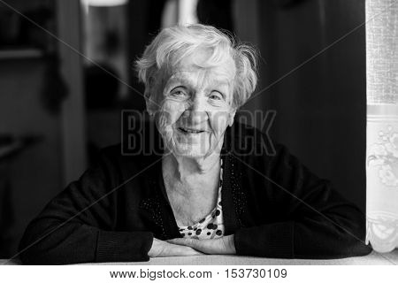 Elderly woman portrait. Black-and-white photo of high contrast.
