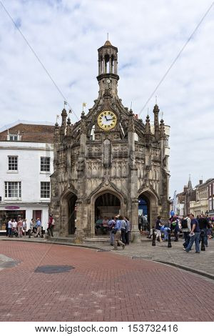 Chichester, Great Britain - May 17, 2014: Chichester Cross, a perpendicular market cross in the centre of the city of Chichester, West Sussex. People inside and nearby.