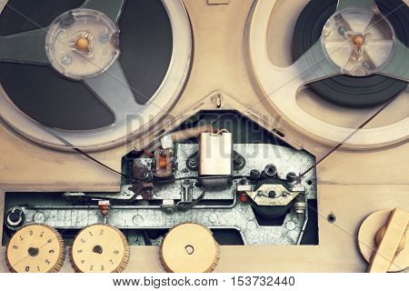 Old audio equipment. Tape recorder.The photo is tinted in a retro style.Household appliances audio retro 60s .