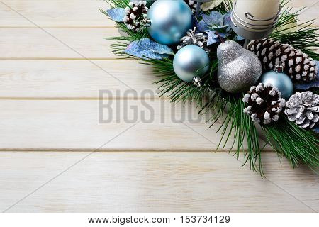 Christmas background with holiday decorated candleholder and blue ornaments. Christmas decoration with pine cones. Christmas greeting background. Copy space.