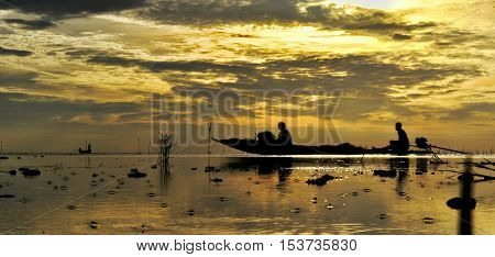 The drift boat on the sea with bluesky and goldsky sunrise backgrund.