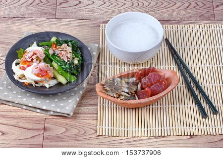 Home made,Rice gruel and  side dish as shredded of fried sun-dried fish ,Chinese sausage,spicy salted egg salad and fried kale with salted fish.