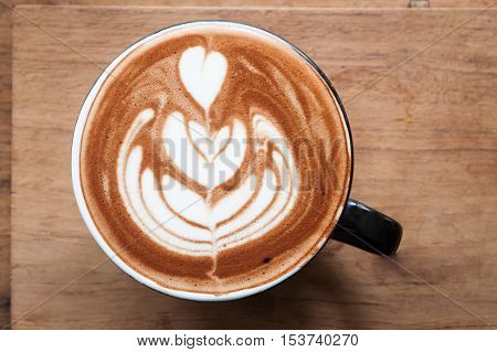 Top view of hot coffee on wooden table, stock photo