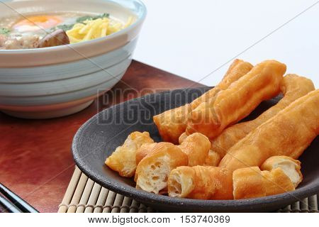 Close up of ready served as Patongko (deep-fried dough stick) . Selective focus.