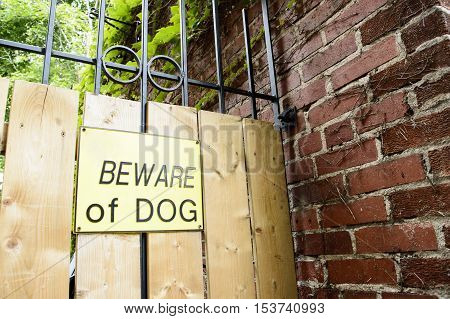 Beware of dog sign, danger warning preventing people from entering home to let them know dog is on premises and avoid trespassers or burglars and protect owner liability