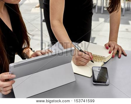 Two Women Having A Business Meeting Outdoors