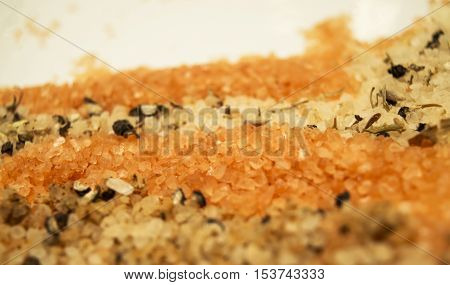 Different flavored salt close-up for cooking in brghtly colored natural flavors including alaea salt, sea salt and rock salt with natural herbs and spices for gourmet international flavored and hawaiian cuisine