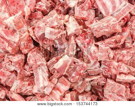 Closeup pile of raw pork bone with some pork for cook textured background