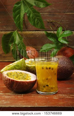 passion fruit juice in glass on background