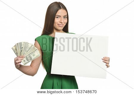 Beautiful woman in green dress with money and blank billboard on white background