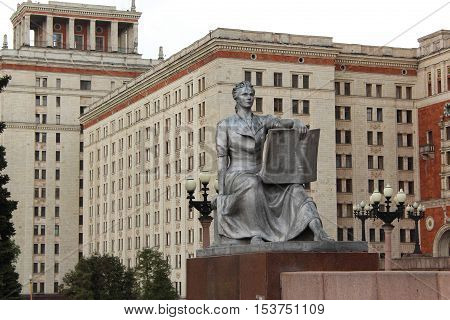 The statue of a girl with a book next to the entrance to the main building of Moscow State University (MSU) named after Lomonosov in Moscow