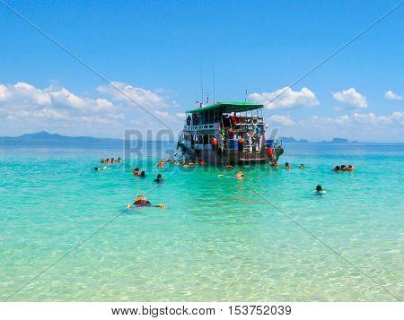 Tourists snorkeling in Andaman sea at Ko Kradan Island Thailand