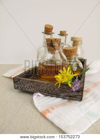 Vegetable oils for the skin care in bottles on a tray