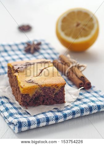 Thanksgiving treatment. Marble chocolate brownies with pumpkin. Freshly baked homemade brownie. Selective focus on the front. Vertical.