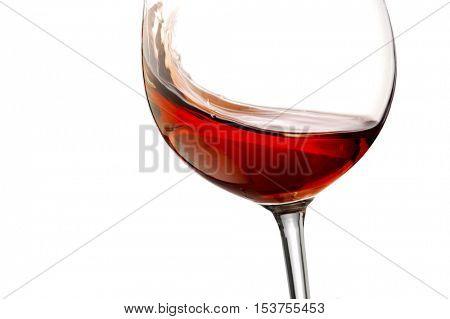 Red wine splash with white background, close up