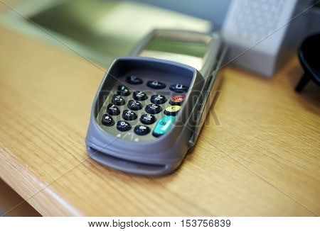 finance, technology, cash free and payment concept - money terminal or bank card reader