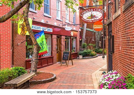 PORTSMOUTH, NEW HAMPSHIRE - SEPTEMBER 28, 2016: Stores and restuarants on historic Commercial Alley in Portsmouth.