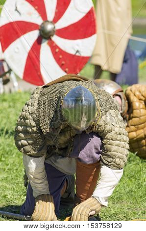The prostrate Viking kneels down as a sign of the defeat. The annual festival of the Norwegian Vikings which is taking place in May in St. Petersburg (Russia).