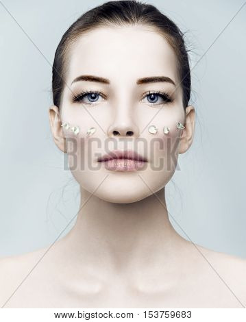 Fashion Beautiful Woman With Drops Of Gel On Another Cheek