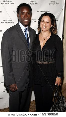 Bridgid Coulter and Don Cheadle at the Archbishop Desmond Tutu's 75th Birthday Party held at the Regent Beverly Wilshire Hotel in Beverly Hills, USA on September 18, 2006.