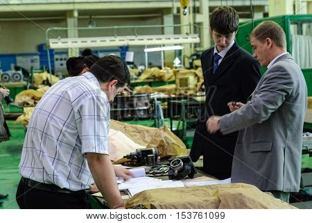 Tyumen, Russia - November 14, 2007: JSC Tyumenskie Motorostroiteli. Plant on production and repair of aviation engines. industrial quality control against factory background