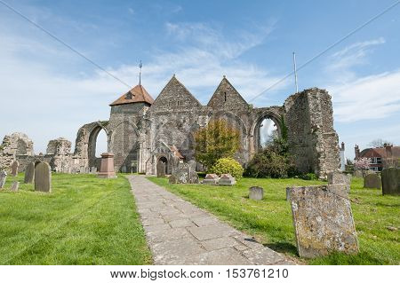WINCHELSEA, UK - APRIL 17: Ancient ruins and more recent architecture of the parish church in Winchelsea, UK on April 17, 2014