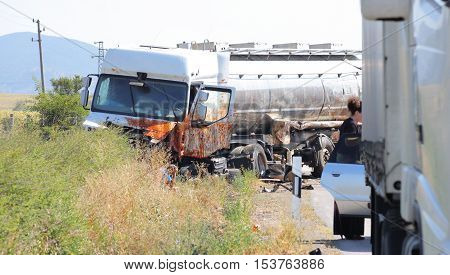 Horizontal image of a tank transporter truck vehicle wreck.
