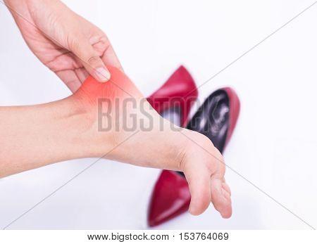 Heel pain in women Woman massaging her foot.