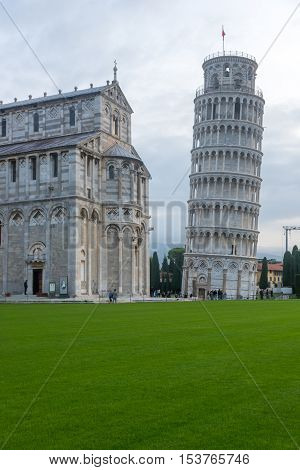 Pisa Italy - October 22 2016: Tourists visiting the Leaning Tower of Pisa and Pisa Cathedral in Italy. The Tower of Pisa is one of Italy's most iconic tourist attractions and is famous worldwide for its unintended tilt.