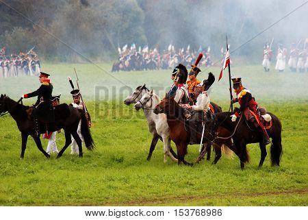 BORODINO MOSCOW REGION - SEPTEMBER 04 2016: Reenactors dressed as Napoleonic war soldiers ride horses at Borodino battle historical reenactment in Russia. Color photo.