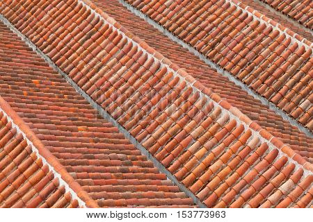 Orange old roof tiles background in Chefchaouen medina, Morocco