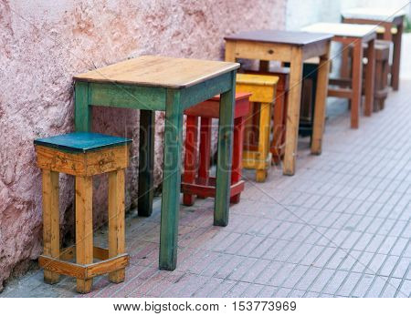 Uncovered dining tables in coffee bar on the street in Essaouira, Morocco