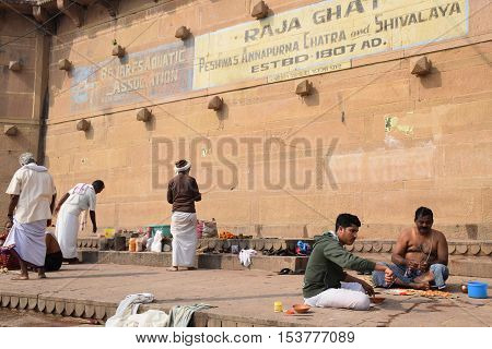 VARANASI, UTTAR PRADESH, INDIA - FEBRUARY 17, 2016 - Unidentified indian people on Raja ghat in the holy city of Varanasi, the spiritual capital of India