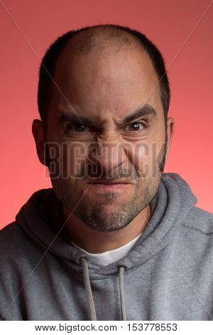 Man making a weird face with a red background