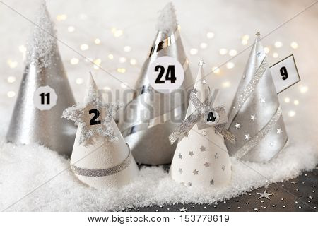 Festive Advent calendar with lights and snow