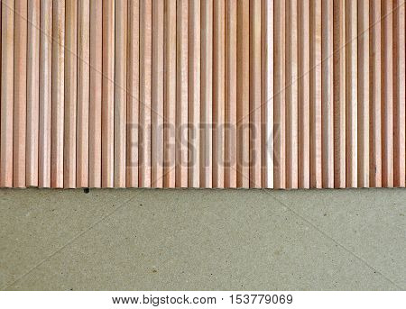 A lot of wooden pencils on brown surface top view. Background with space for text.