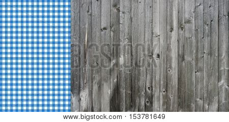 Rustic wooden background with blue and white checkered tablecloth