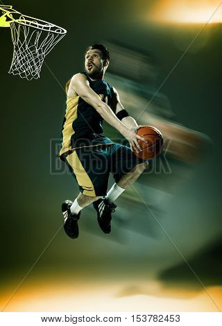 Full length portrait of a basketball player with a ball