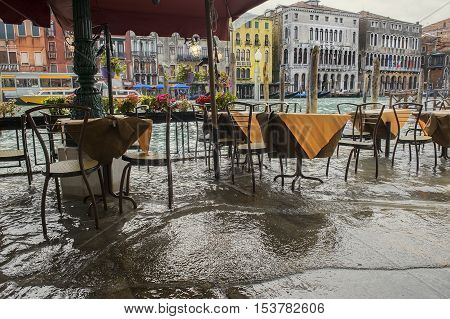 Venice during a flood, flooded restaurant on the waterfront of Grand Canal