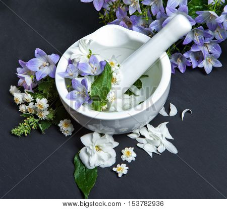 Spa background with flowers. Hygiene items for bath and spa.