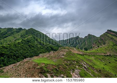 Scenic mountain landscape with aules and dramatic sky poster