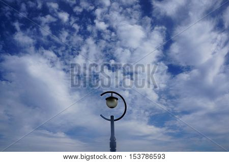 lamplight and scattered cloud on clear sky