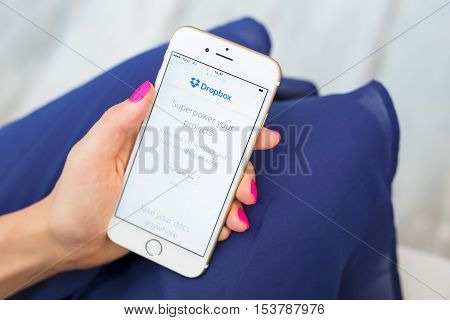 RIGA LATVIA - SEPTEMBER 8 2016: Dropbox homepage on smartphone. Dropbox is a file hosting service that offers cloud storage file synchronization personal cloud and client software.