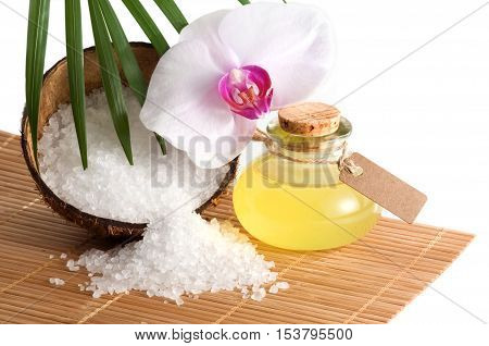 Tropical spa still life with orchid blossom and essential oil