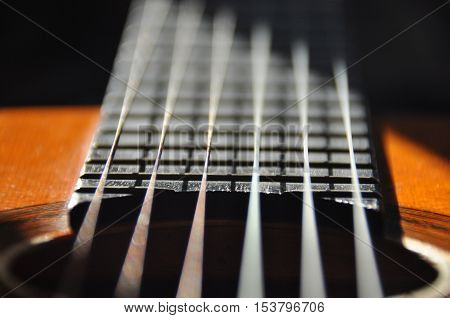 Classical guitar. Issuing a stringed instrument sounds. Fretboard strings and resonation