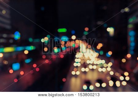 Abstact blur bokeh of Evening traffic jam on road in city. Vintage tone