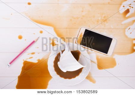 Top view Coffee spilled on smart phone on table , Repair concept