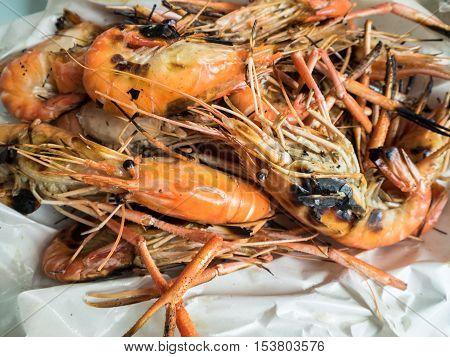 Grilled prawns Thai seafood in box for sale.