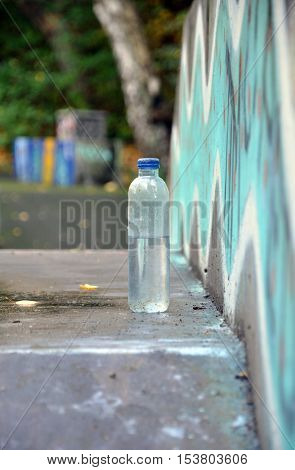 Water bottle on the concrete with grafitti