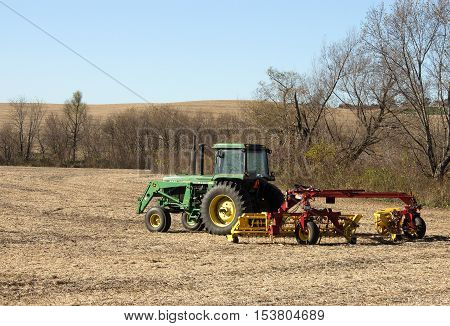 RIVER FALLS,WISCONSIN-OCTOBER 28,2016: A John Deere tractor on a Wisconsin crop field.